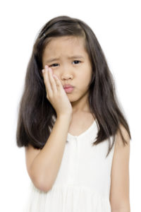 Little girl with toothache action looking for an emergency dentist in San Antonio, TX.