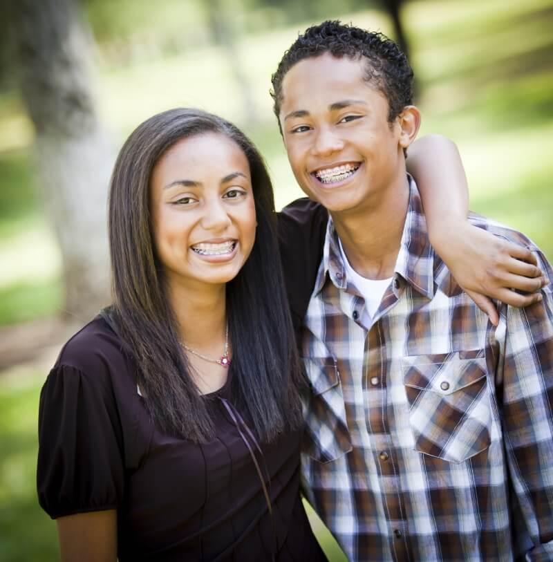 Brother and sister who off their braces they got at Helotes Pediatric Dentistry and Orthodontics in San Antonio, TX.