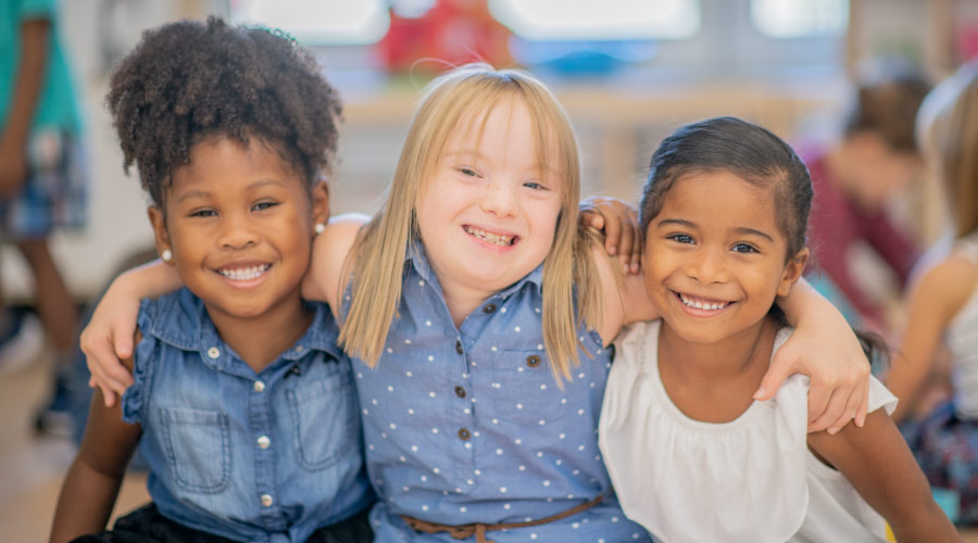 3 young girls smile together at Helotes Pediatric Dentistry & Orthodontics in San Antonio, TX