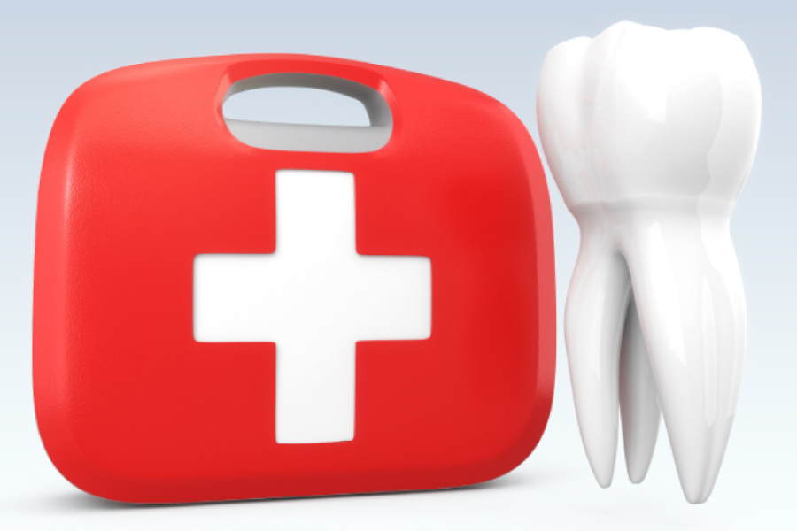 Emergency kit next to the model of a tooth.