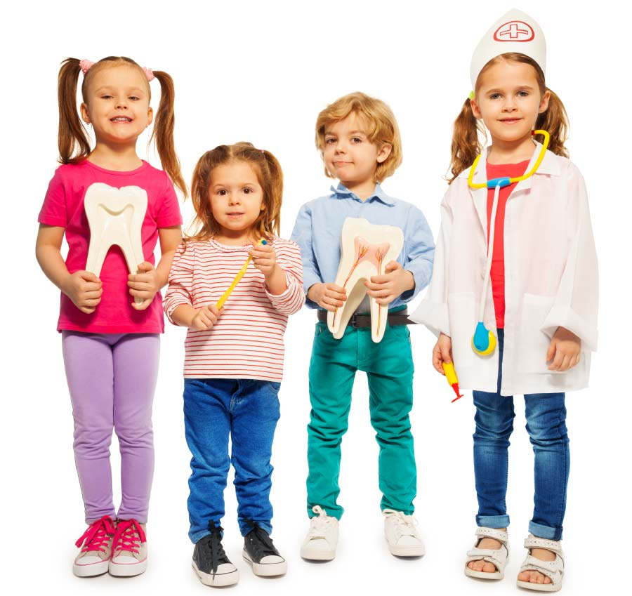 Two kids holding tooth models, one holding a big toothbrush and another dressed up as a dentist.